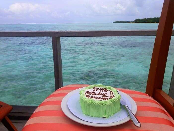 Cake cutting ceremony in water villa in Maldives