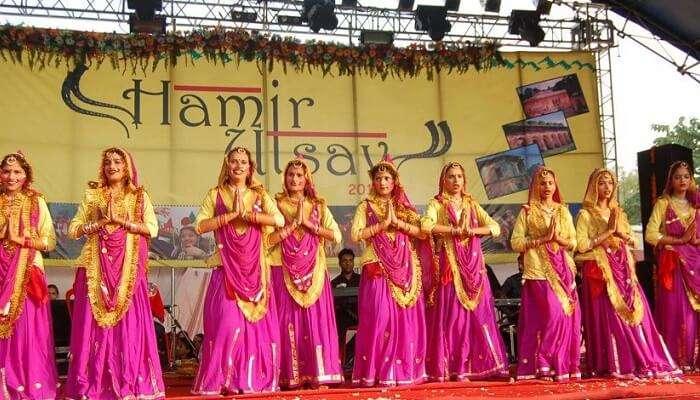 Dancers performing a cultural dance during the Hamir Utsav