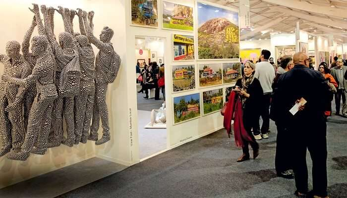 Art enthusiasts admiring the beautiful paintings and art pieces during the India Art Festival in Mumbai