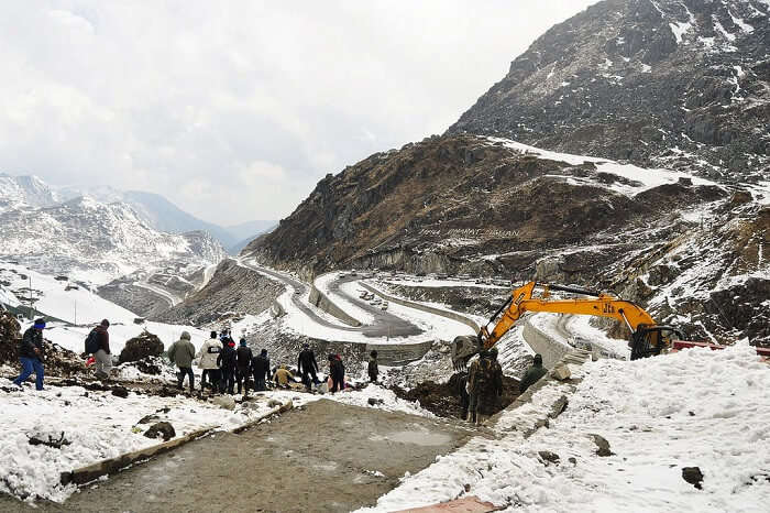 JCB removing snow from the zig-zag roads of Nathula Pass