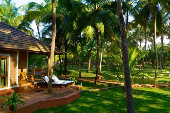 A private sitting outside a villa at the Nattika Beach Ayurveda Resort