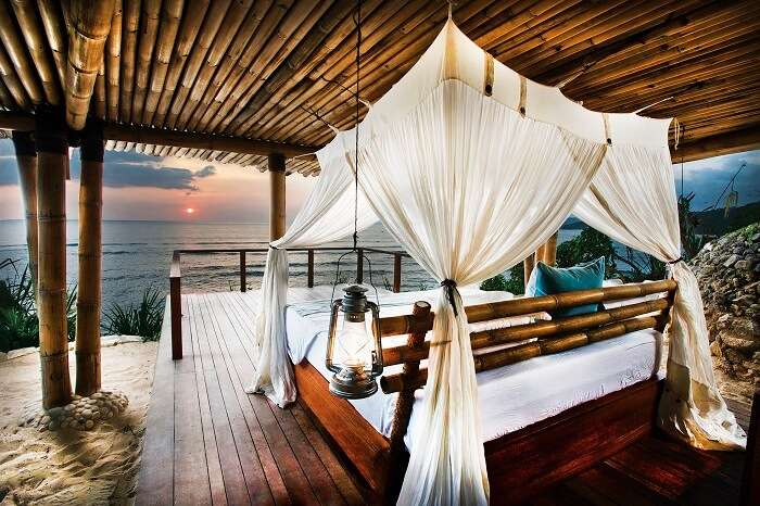 A view of the sea from the bedroom of the chic Nihiwatu Beach resort in Sumba