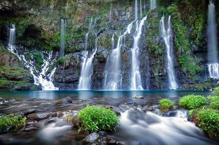 Panoramic view of waterfall on river Langevin in tropical jungle at Reunion Island