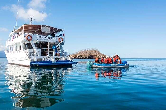 Tourists on a dinghy returning to a cruise ship in the Galapagos Islands