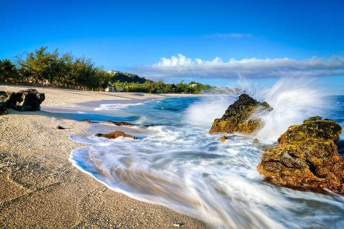 Waves lapping on the sandy beach at Boucan Canot on Reunion Island in the Indian Ocean