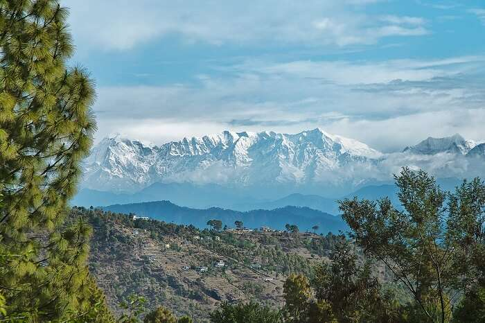 A distant shot of the snowcapped Himalayas surrounding the Almora district in Uttarakhand