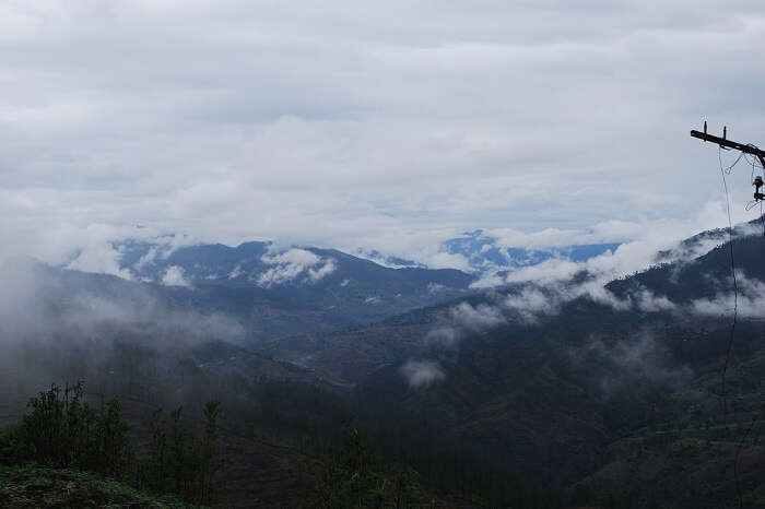 Mist takes cover over the hills of Binsar