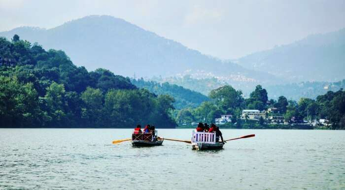 engaging in boating at bhimtal