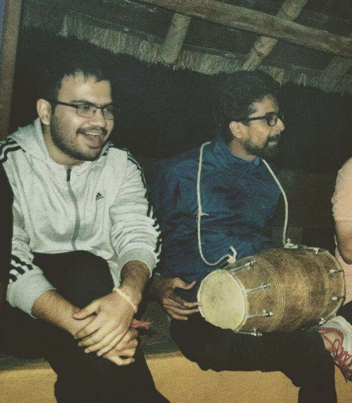 my friends playing dholak at the camp and singing songs