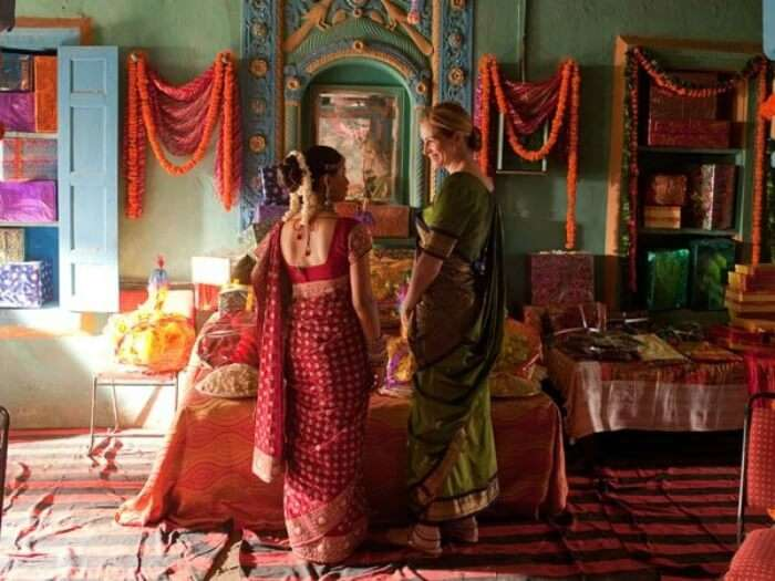 scene from Eat Pray Love with Julia in saree with Indian woman