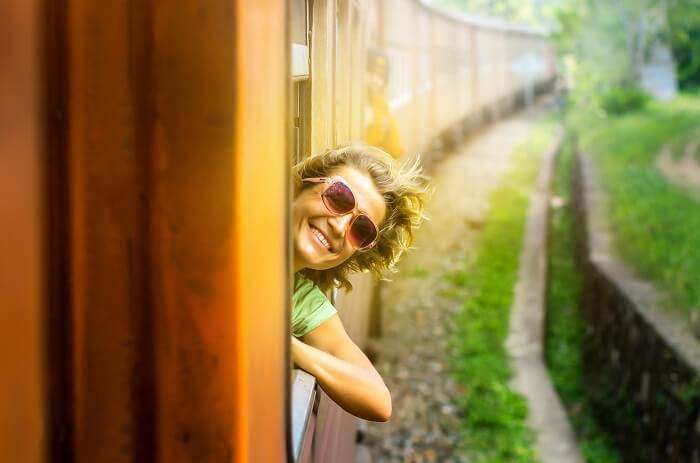 a happy kid in a train experiencing the joy of traveling