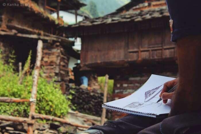 a close up of rahul sketching