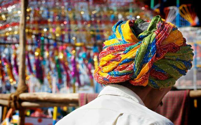 Local man in colorful turban in a market in Pushkar