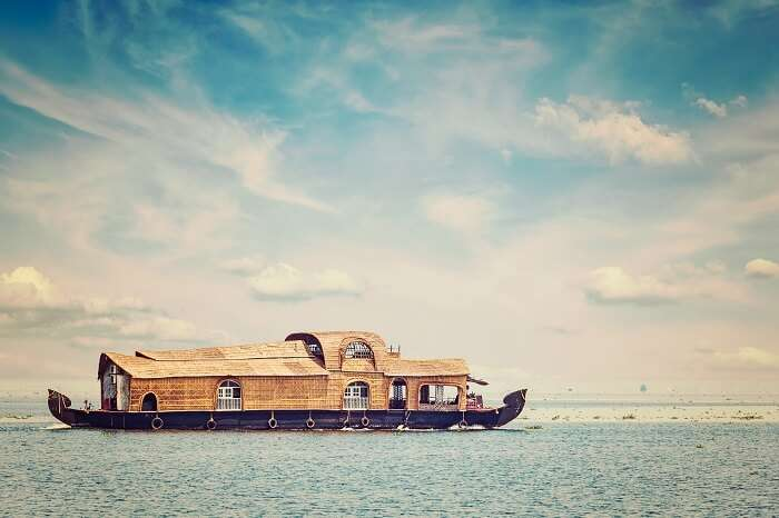 Retro styled image of houseboat in Vembanadu Lake