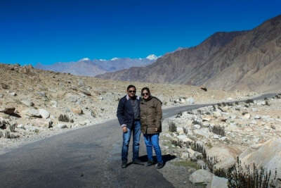 Abhishek and his wife posing before the Magnetic Hill on their trip to Ladakh