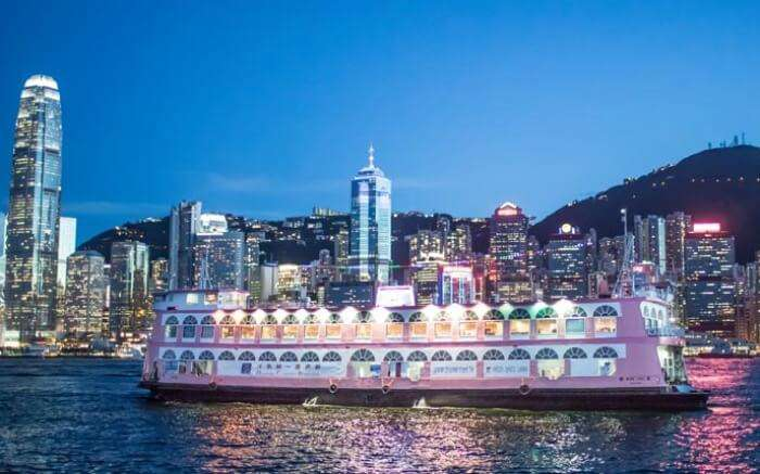 A cruise with Hong Kong skyline in backdrop