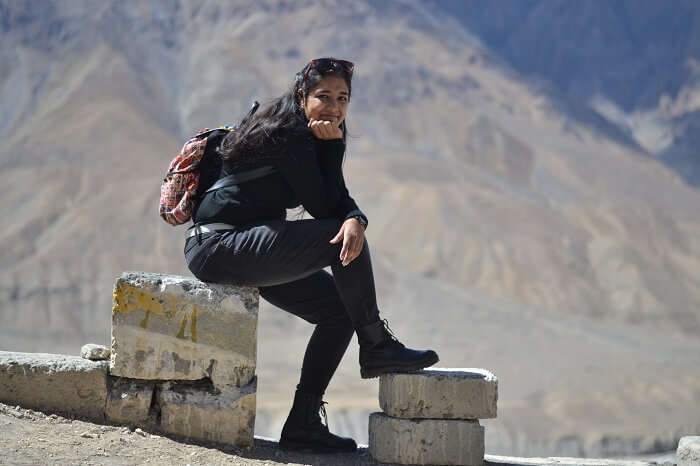 Avni sits on a stone in Kaza