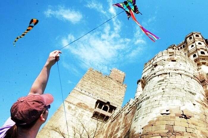 A tourist flies a kite during the International Kite Festival in Jodhpur
