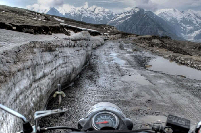 The treacherous path leading to Rohtang is mostly mud and snow