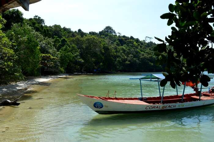 A boat standing by the quiet Coral beach in Koh Ta Kiev