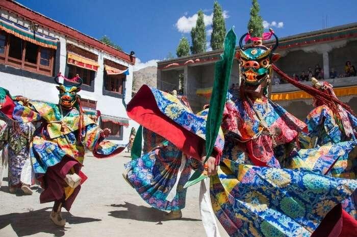 Ladakhis wearing silk costumes and mask celebrate Phyang in Leh