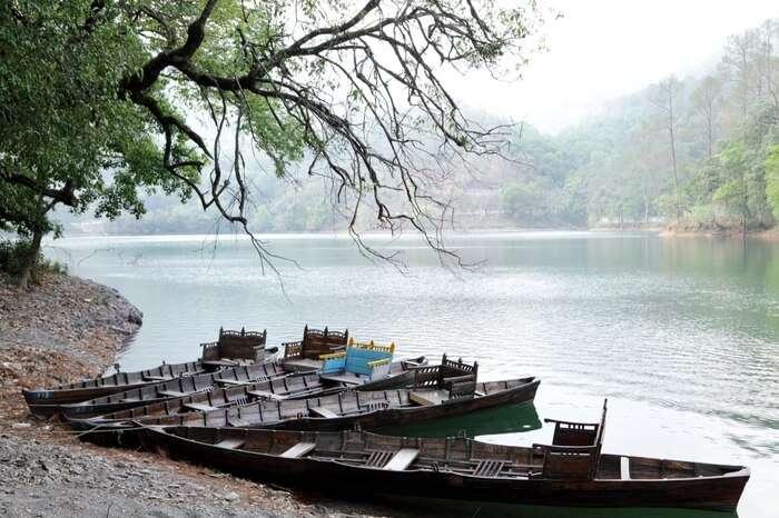 Boats waiting by the banks of Sattal lake in Nainital