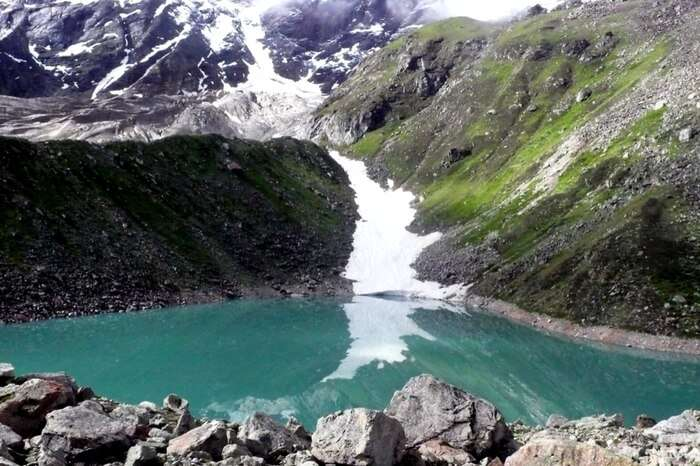 A picturesque Satopanth lake surrounded by imposing peaks
