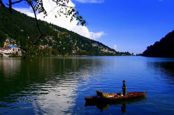 A boat approaching the shore of Bhimtal lake in Kumaon