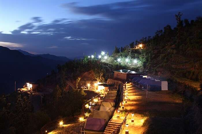 A night shot of the Whispering Pines camping resort in Dhanaulti
