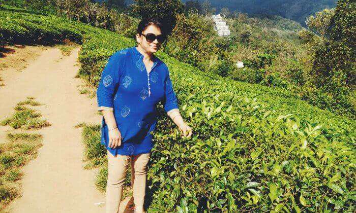 Anuj's wife posing before the tea plantations