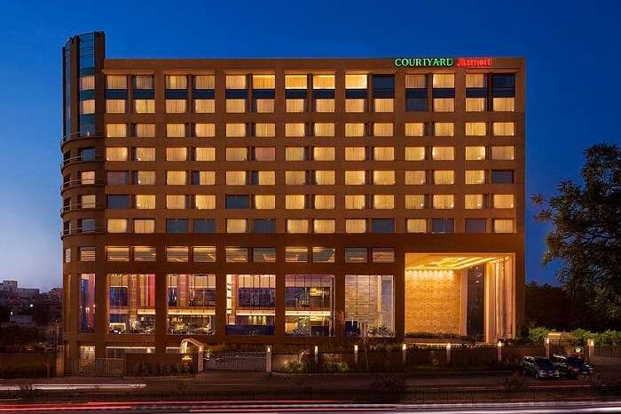 An evening shot of the drive-in to the Courtyard by Marriott Ahmedabad