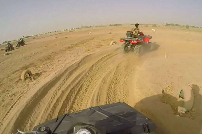 Tourists try their hands on quadbiking in Jaisalmer