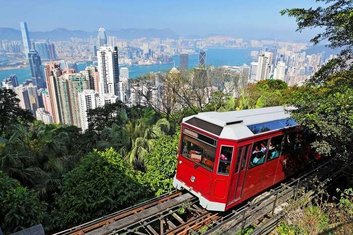 Tourists riding the famous Victoria Tram in Hong Kong