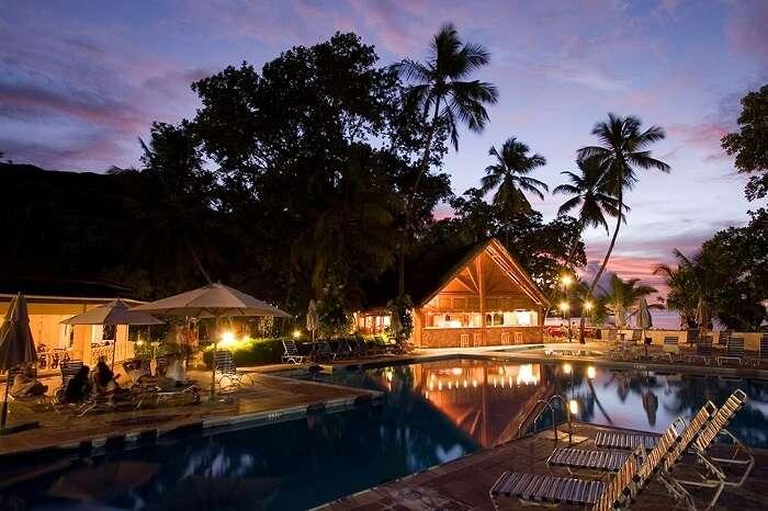 A night shot of the swimming pool at the Berjaya Beau Vallon Bay resort