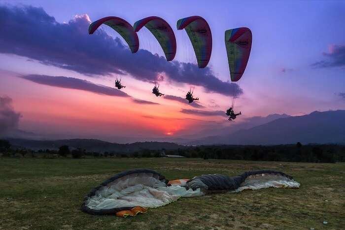 Tourists enjoying paragliding at Bir Billing
