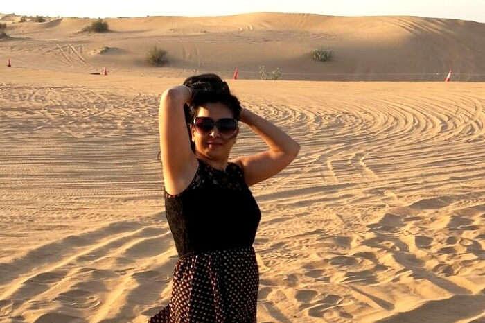 Female traveler posing in the desert area