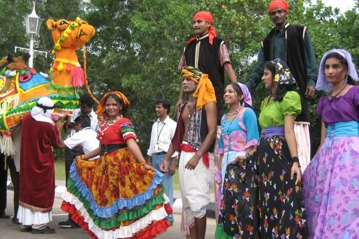 Locals dressed in colorful clothes taking part in the Cochin Festival