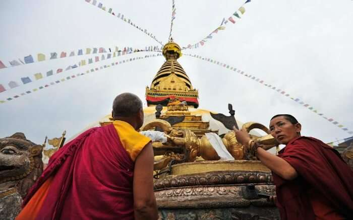 Buddhist monks make offerings during Losar Festival in Nepal