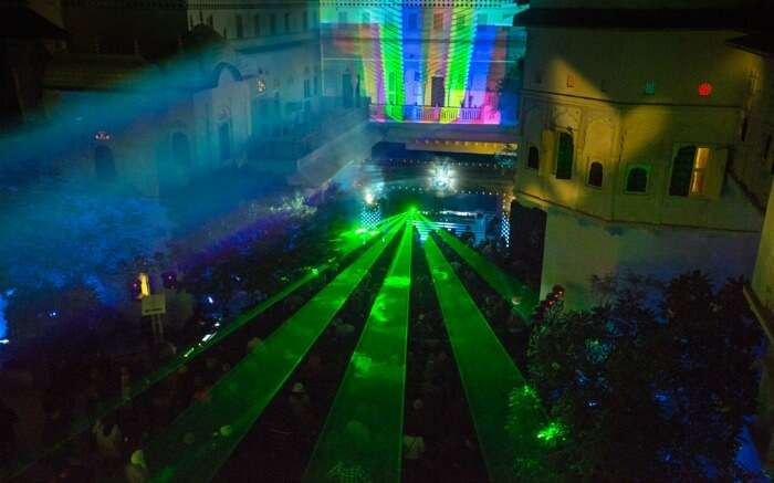 Colorful laser lights during Magnetic Fields Festival in Jaipur - one of the best places to visit in Rajasthan in winter