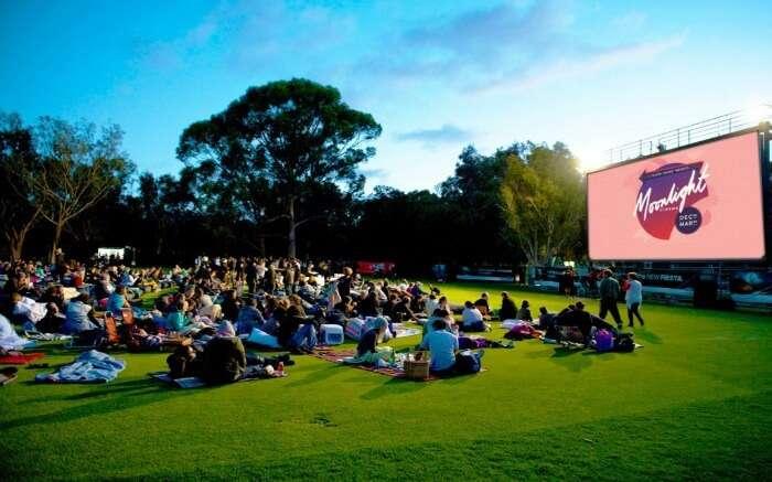 People on the ground at Moonlight Cinema in Australia