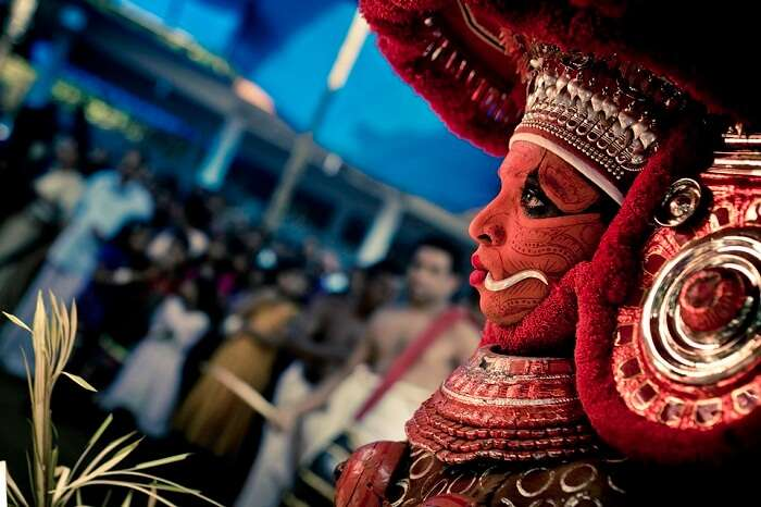 A performer at the grand celebrations of Perumthitta Tharavad festival in Kerala