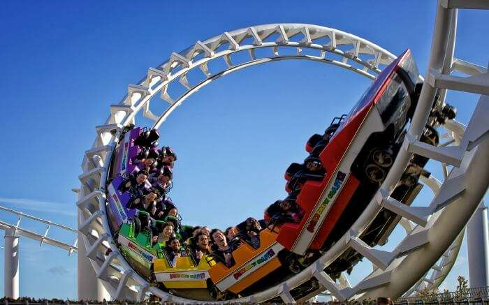 People enjoying rollercoaster ride in Rainbow's End theme park in Auckland