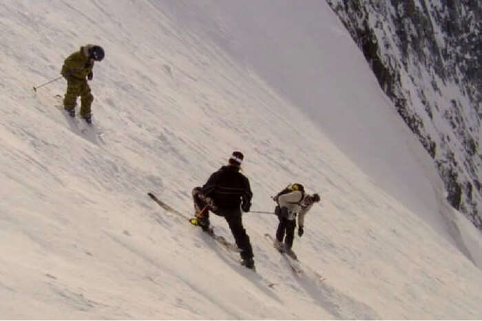 Adventurers skiing on the mountain slope in the documentary The Edge of Never