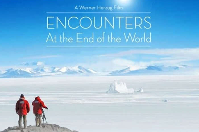 Travelers taking photographs at McMurdo Station in Antarctica in a scene from the documentary Encounters at the End of the World
