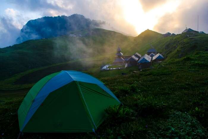 A quiet and picturesque campsite near Prashar Lake in Himachal