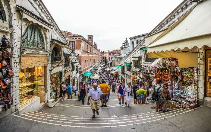 People in a busy street doing shopping which is one of the best things to do in Venice