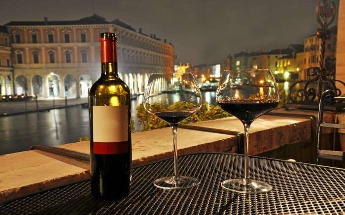 Glasses and bottle of red wine in Venice