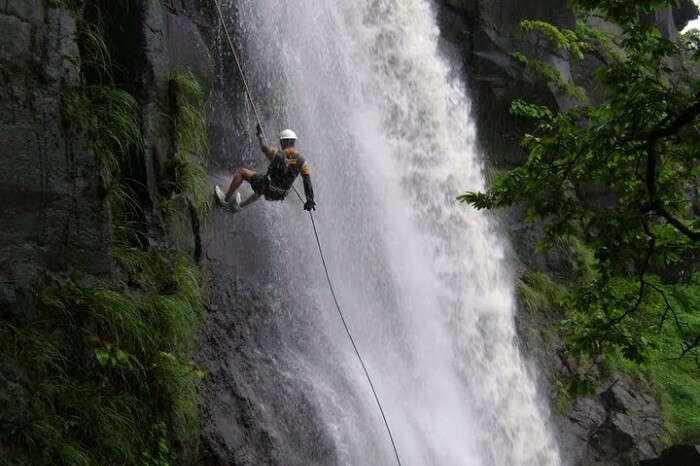 A person tries waterfall rappelling that is one of the best things to do in Chakrata