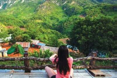 A girl relaxes and enjoys the beautiful views at one of the weekend getaways from Delhi