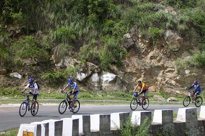 A group of people cycling in Chakrata